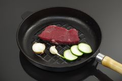 Black pan with meat. Black pan with beef meat and onion Stock Images