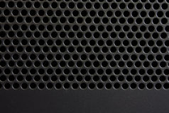Black panel. Background the black panel with round apertures Royalty Free Stock Photo