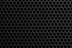 Black panel. Background the black panel with round apertures Stock Photo