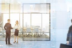 Panoramic meeting room lobby mock up, people. Black panoramic boardroom interior with a concrete floor, a long wooden table and white chairs. A company name Royalty Free Stock Image