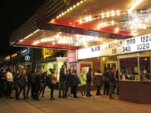 Black Panther Movie Now Showing. Photo of long line of people at the uptown movie theater at night in washington dc on 2/16/18. They are lining up to see the Stock Images