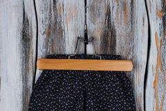 Black pants on wooden hanger Stock Photos