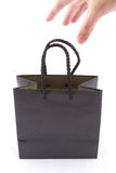 The black paper bag with carry hand for shopping Stock Photography