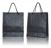 Black paper bag on white background Stock Photo
