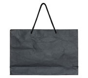 Black paper bag on white Stock Photography