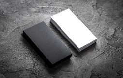 Black paper business card template. On grey background. Blank name card for text space stock photo