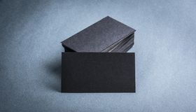 Black paper business card template. On grey background. Blank name card for text space royalty free stock photos