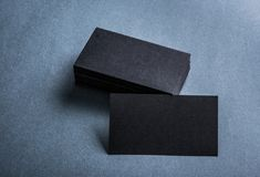 Black paper business card template. On grey background. Blank name card for text space royalty free stock image