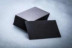 Black paper business card template. On grey background. Blank name card for text space stock photography