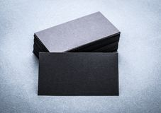 Black paper business card template. On grey background. Blank name card for text space royalty free stock photo
