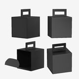 Black paper carton box with handle, clipping path included Royalty Free Stock Photo