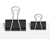 Black Paper clip. Vector Stock Photos