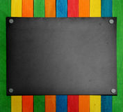 Black paper on the colorful wood Stock Image