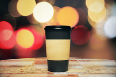 Black paper cup of coffee to go on the wooden table Stock Photography