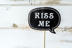Kiss Me Paper Party Accessory. Black Paper Kiss me note.Party accessory Royalty Free Stock Photography