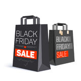 Black paper shopping bag with ad text. Black friday sale and with labels from the purchase on the bag. 3D illustration Stock Image