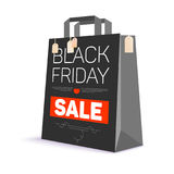 Black paper shopping bag with ad text. Black friday sale  Royalty Free Stock Photo
