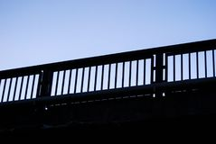 Black parapet. Metal parapet of a bridge with blue sky Royalty Free Stock Photo