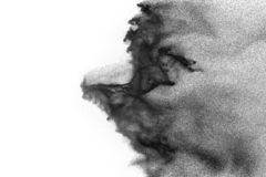 Black particles splatter on white background. Black powder dust burst.  royalty free stock photography
