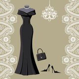 Black party dress with chandelier and paisley border Stock Photo