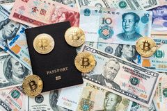Black passport on background, proof identity. Against paper money, US dollars, Chinese yuan CNY, metal coins, bitcoin. Black passport on the background, proof of Stock Image