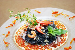 Black pasta with lobster Stock Image