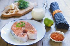Black pasta with salmon and red caviar in cream sauce. Cooking process. Step 1. Ingredients Royalty Free Stock Image