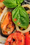 Black Pasta with sea food and basil Stock Images