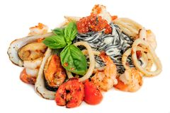 Black Pasta with sea food and basil Royalty Free Stock Photography