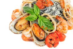 Black Pasta with sea food and basil Stock Photos
