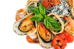 Black Pasta with sea food and basil Stock Photo