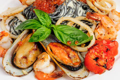 Black Pasta with sea food and basil Royalty Free Stock Images
