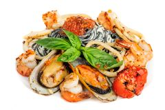 Black Pasta with sea food and basil Royalty Free Stock Image