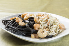 Black pasta with seafood delicacies Royalty Free Stock Photos