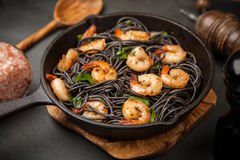 Black pasta with shrimps Royalty Free Stock Photography