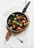 Black pasta spaghetti with shrimps, basil, pesto Stock Photos
