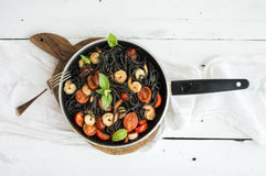 Black pasta spaghetti with shrimps, basil, pesto Royalty Free Stock Image