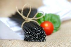 Black Pasta of Squid Ink. Black spaghetti pasta made with squid ink Stock Photos