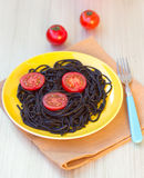 Black pasta  with tomatoes Royalty Free Stock Image