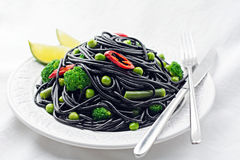 Black pasta with vegetables royalty free stock photo