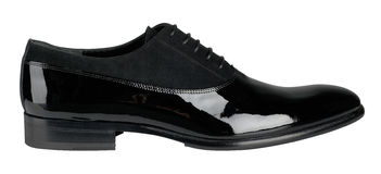 Black patent leather male shoes. Isolated on a white background stock photography