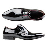 Black patent leather men shoes against white. Background Royalty Free Stock Images