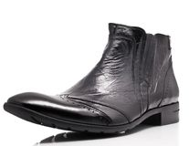 Black patent leather mens boot. Over white background Stock Photos