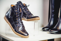 Black patent leather shoes lie on the shelf Stock Image