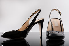 Black patent leather shoes on mirror surface Stock Photography
