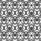 Black patterns. Graceful decorative wallpaper with black patterns Royalty Free Stock Image