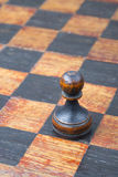 Black pawn chessboard Stock Photography