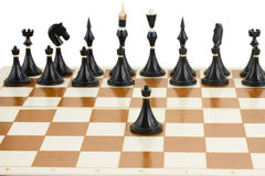 Black pawn in front of black chess Stock Photography