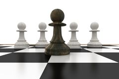 Black pawn in front of white pawns Royalty Free Stock Photos