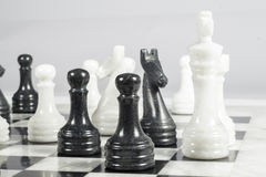 Black pawn gives checkmate to white king Royalty Free Stock Photo